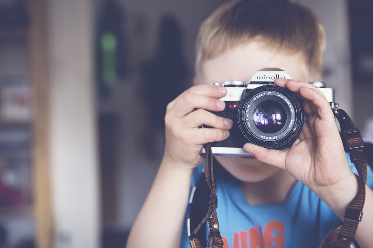 Secure photo sharing using a child care app