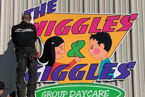 wiggles and giggles sign