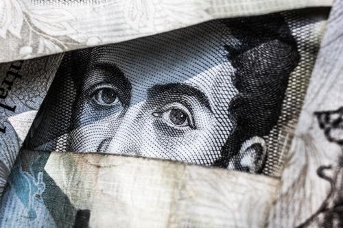 dollar bills framing eyes