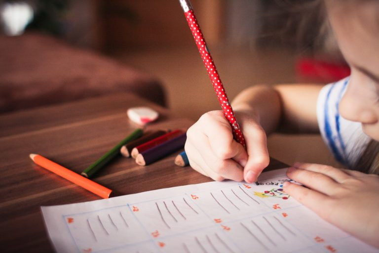child writing in classroom