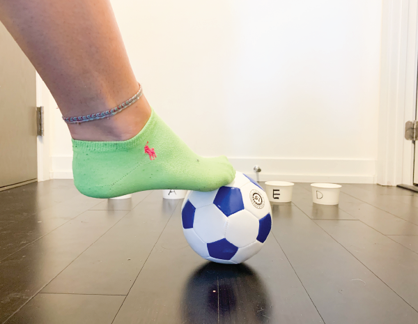 kick the cup preschool toddler gross motor skills activity